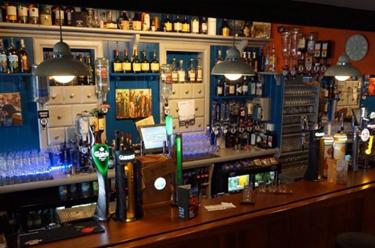 Back Bar Shelves at Paul Geaney's Bar & Restaurant Dingle Wild Atlantic Way Thumbnail