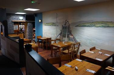 Seating Area of Paul Geaney's Bar & Restaurant Dingle Wild Atlantic WayThumbnail