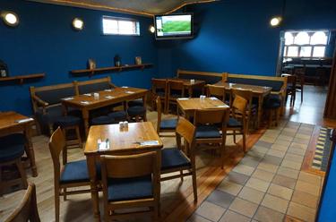 Back Seating Area of Paul Geaney's Bar & Restaurant Dingle Wild Atlantic Way Thumbnail