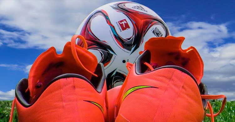 Orange Football Boots and Soccer Ball