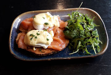 Poached Eggs and smoked salmon on sliced bloomer bread with hollandaise sauce and greens at Paul Geaney's Bar & Restaurant Dingle Wild Atlantic Way
